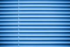 蓝色百叶窗 免版税库存照片