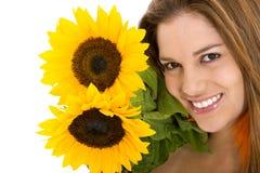 солнцецветы девушки Стоковая Фотография RF
