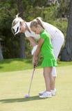 高尔夫球课 免版税库存照片