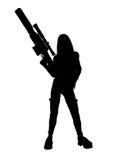 γυναίκα σκιαγραφιών εκμετάλλευσης πυροβόλων όπλων Στοκ φωτογραφίες με δικαίωμα ελεύθερης χρήσης