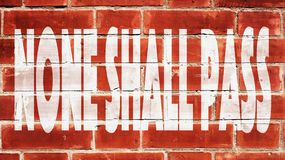 None Shall Pass On A Brick Wall. None Shall Pass Written On A Brick Wall royalty free stock image