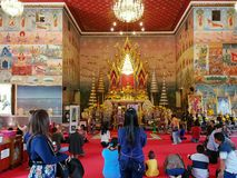 NONG KHAI, THAILAND - MARCH 3, 2018: Many people come to visit P. Ho Chai temple and pay their respect to Golden Buddha statue on March 3, 2018 in Nong Khai royalty free stock photography
