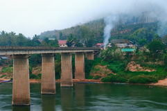 Nong Khiaw Bridge at misty morning Royalty Free Stock Image
