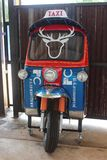 Some part of a tricycle. NONGBUALAMPHU, THAILAND – JUNE 16, 2018 : Some part of a tricycle, which be the vehicle that is famous and know generally in stock photography