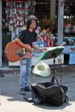 One man is singing in the market. royalty free stock image