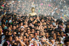 NONGKHAI THAILAND APRIL 13: Songkran Festival. The people pour water and joined parade of the statue of Luang Pho Phra Sai with respect to faith on April 13 Royalty Free Stock Images
