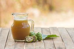 Noni juice. The benefit of Noni juice is to help drive the wind, nourish the elements, help to appetite. Helps drive menstruation, cure flatulence, cure nausea royalty free stock images