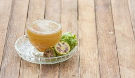 Noni juice. The benefit of Noni juice is to help drive the wind, nourish the elements, help to appetite. Helps drive menstruation, cure flatulence, cure nausea royalty free stock photos