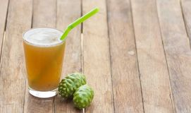 Noni juice. The benefit of Noni juice is to help drive the wind, nourish the elements, help to appetite. Helps drive menstruation, cure flatulence, cure nausea stock photos