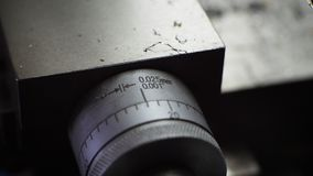 Nonio graduated in millimeters and inches for lathe. Nonio graduated cross car component of lathe for metals Royalty Free Stock Photos