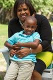 Nonna che abbraccia il suo nipote Fotografia Stock Libera da Diritti