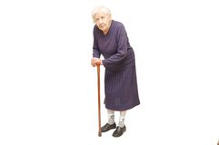 Nonna che tiene una canna Fotografie Stock Libere da Diritti