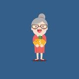 Nonna con il porcellino salvadanaio dorato Immagine Stock Libera da Diritti