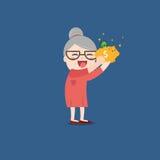 Nonna con il porcellino salvadanaio dorato Immagine Stock