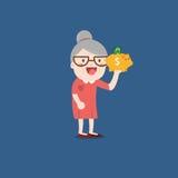 Nonna con il porcellino salvadanaio dorato Fotografia Stock Libera da Diritti