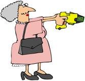 Nonna con una pistola di stordimento Immagini Stock