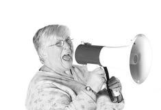 Nonna gridante del b&w immagini stock