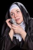 Nonne avec l'argent Images libres de droits