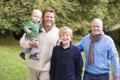Nonno che cammina con il padre ed il nipote Fotografia Stock Libera da Diritti