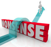 Nonsense Jumping Over Word Common Sense Vs Illogical. Nonsense word and arrow jumping over it to illustrate the battle between sense and nonsensical thought or Royalty Free Stock Photo