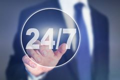 Nonstop service support concept, button 24/7. On touch screen Royalty Free Stock Images