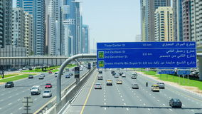 Nonstop traffic at Sheikh Zayed road, time lapse from above carriageway. Wide angle shot of inter-city arterial highway stock footage