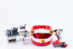 Nonthabure, Thailand - May, 17, 2017 : Lego stormtrooper helping. Get disinfect of bacteria on red plastic chattering teeth isolated on white background royalty free stock images