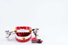Nonthabure, Thailand - May, 17, 2017 : Lego stormtrooper helping. Get disinfect of bacteria on red plastic chattering teeth isolated on white background stock image