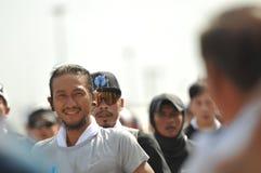 Nonthaburi - DEC 6 2017: På vägen av thailändska för Toon Bodyslam för kändisvippa` tagande ` på 55 dag rinnande maraton att lyft Royaltyfria Foton