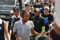 Nonthaburi - DEC 6 2017 : On the way of Thai celebrity rocker `Toon Bodyslam` takes on 55-day running marathon to raise money for. Public hospitals, 2,191-km Stock Image