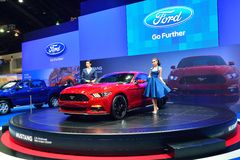NONTHABURI - DECEMBER 1: Model Poses with Ford Mustang 2.3L ecob Stock Photography