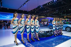 NONTHABURI - DECEMBER 8: Unidentified many modelling posted with BMW 420d Coupe Sport Stock Images