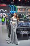 Unidentified model with Isuzu D-Max pick up on display at The 35th Thailand International Motor Expo on November 28 royalty free stock photography