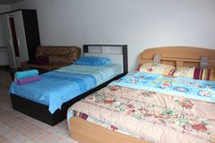 Two beds in rented room. royalty free stock images