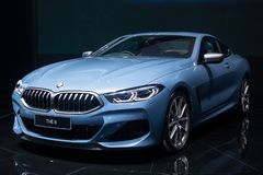 Nonthaburi , Thailand - Dec 6, 2018: BMW the 8 Series Coupe blue color in motor expo , black background royalty free stock image