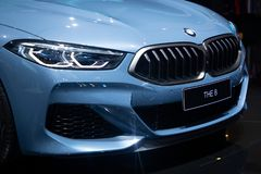 Nonthaburi , Thailand - Dec 6, 2018: BMW the 8 Series Coupe blue color in motor expo , close up car bonnet and headlights royalty free stock photography