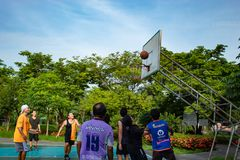 Nonthaburi in Thailand ,Men and women play basketball in the morning to health.31/5/61 stock photography