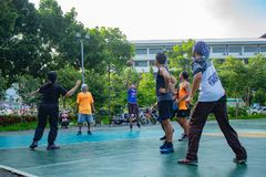 Nonthaburi in Thailand ,Men and women play basketball in the mor royalty free stock images