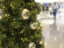 Nonthaburi, Thailand - November 11, 2018 : Beautiful Xmas tree decorated with silver and gold sparkling ball in the department. Store for celebrate christmas royalty free stock photography