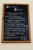 Nonza,菜单,黑板,食物,本机,传统,欧特Corse,可西嘉岛,上部可西嘉岛,法国,欧洲,海岛 图库摄影