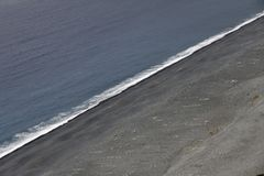 Nonza grå färg sätter på land på västkusten av Cap Corse, Korsika, Frankrike Royaltyfria Bilder