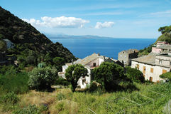 Nonza village with sea view. Corsica Stock Images