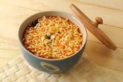 Noodle in bowl. Instant noodle in a porcelain bowl with lid opened Stock Photos