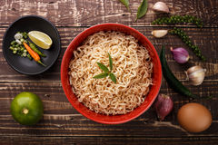 Noodle in bowl and ingredients on wood top view. Noodle in bowl and ingredients on wood background top view Royalty Free Stock Photo