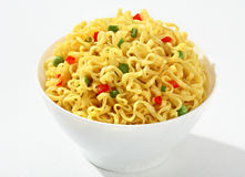 Noodle bowl. Vermicelli with green peas and chopped bell pepper in a white bowl - on white background Stock Photos