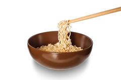 Noodle in brown bowl with chopsticks isolated, Clipping path Royalty Free Stock Photos