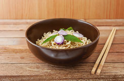 Noodle in brown bowl with wooden chopsticks Stock Photos