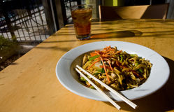 Noodle Dish and Iced Tea Royalty Free Stock Images