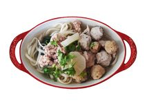 Noodle with fish balls. Noodle with fish and shrimp balls and grounded pork in chicken and radish soup Royalty Free Stock Photography