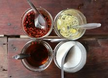 Noodle  flavoring. Noodle Ingredients or garnish or flavoring on the wood table.At Thailand Royalty Free Stock Photo
